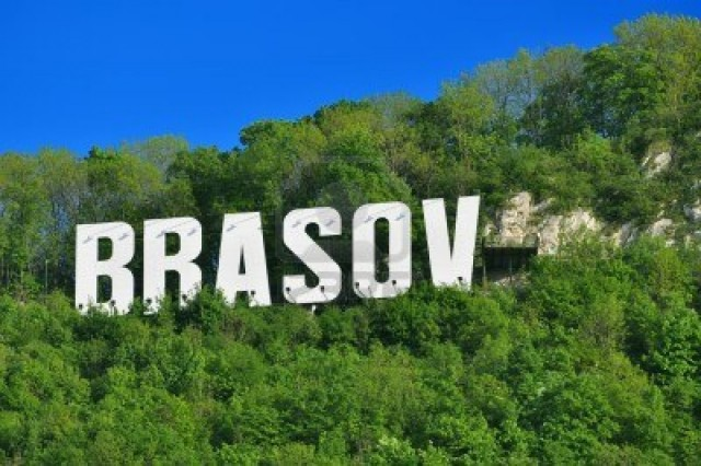 The-Name-of-the-Brasov-City-in-Romania-in-Volumetric-Letters-on-Tampa-Mountain-on-a-Summer-Day